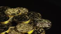 Rotating shot of Bitcoins (digital cryptocurrency) - BITCOIN 0602