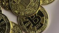 Rotating shot of Bitcoins (digital cryptocurrency) - BITCOIN 0382