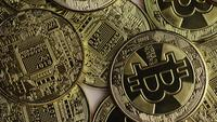 Rotating shot of Bitcoins (digital cryptocurrency) - BITCOIN 0381