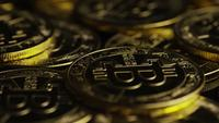 Rotating shot of Bitcoins (digital cryptocurrency) - BITCOIN 0562