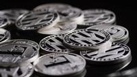 Rotating shot of Bitcoins (digital cryptocurrency) - BITCOIN LITECOIN 554