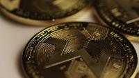 Rotating shot of Bitcoins (digital cryptocurrency) - BITCOIN MONERO 025