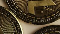Rotating shot of Bitcoins (digital cryptocurrency) - BITCOIN MONERO 009