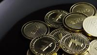 Rotating shot of Bitcoins (digital cryptocurrency) - BITCOIN LITECOIN 315