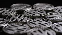 Rotating shot of Bitcoins (digital cryptocurrency) - BITCOIN LITECOIN 406
