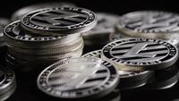 Rotating shot of Bitcoins (digital cryptocurrency) - BITCOIN LITECOIN 380