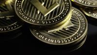 Rotating shot of Bitcoins (digital cryptocurrency) - BITCOIN LITECOIN 247