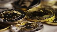 Rotating shot of Bitcoins (digital cryptocurrency) - BITCOIN MIXED 089