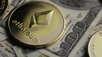 Rotating shot of Bitcoins (digital cryptocurrency) - BITCOIN ETHEREUM 210