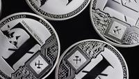 Rotating shot of Bitcoins (digital cryptocurrency) - BITCOIN LITECOIN 444
