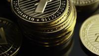Rotating shot of Bitcoins (digital cryptocurrency) - BITCOIN LITECOIN 354