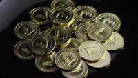 Rotating shot of Bitcoins (digital cryptocurrency) - BITCOIN LITECOIN 237