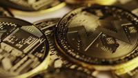 Rotating shot of Bitcoins (digital cryptocurrency) - BITCOIN MONERO 109