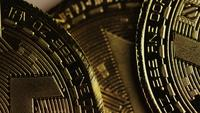 Rotating shot of Bitcoins (digital cryptocurrency) - BITCOIN MONERO 058