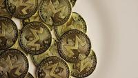 Rotating shot of Bitcoins (digital cryptocurrency) - BITCOIN MONERO 047