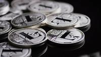 Rotating shot of Bitcoins (digital cryptocurrency) - BITCOIN LITECOIN 493