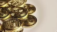 Rotating shot of Bitcoins (digital cryptocurrency) - BITCOIN MONERO 103