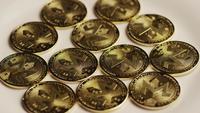 Rotating shot of Bitcoins (digital cryptocurrency) - BITCOIN MONERO 014