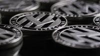 Rotating shot of Bitcoins (digital cryptocurrency) - BITCOIN LITECOIN 409