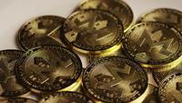 Rotating shot of Bitcoins (digital cryptocurrency) - BITCOIN MONERO 065