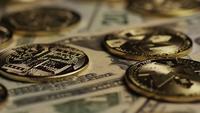 Rotating shot of Bitcoins (digital cryptocurrency) - BITCOIN MONERO 212