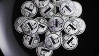 Rotating shot of Bitcoins (digital cryptocurrency) - BITCOIN LITECOIN 470