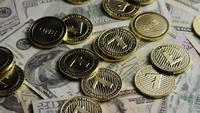 Rotating shot of Bitcoins (digital cryptocurrency) - BITCOIN LITECOIN 573