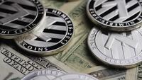 Rotating shot of Bitcoins (digital cryptocurrency) - BITCOIN LITECOIN 610