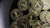 Rotating shot of Bitcoins (digital cryptocurrency) - BITCOIN LITECOIN 227