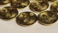 Rotating shot of Bitcoins (digital cryptocurrency) - BITCOIN MONERO 017