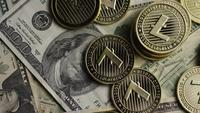 Rotating shot of Bitcoins (digital cryptocurrency) - BITCOIN LITECOIN 565