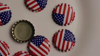 Rotating shot of bottle caps with the American flag printed on them - BOTTLE CAPS 003