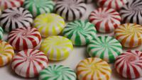 Rotating shot of a colorful mix of various hard candies - CANDY MIXED 016