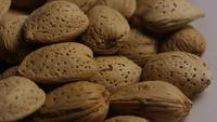 Cinematic, rotating shot of almonds on a white surface - ALMONDS 146
