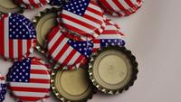 Rotating shot of bottle caps with the American flag printed on them - BOTTLE CAPS 023