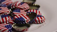 Rotating shot of bottle caps with the American flag printed on them - BOTTLE CAPS 040
