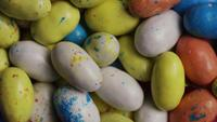 Rotating shot of colorful Easter candies on a bed of easter grass