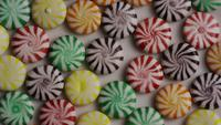 Rotating shot of a colorful mix of various hard candies - CANDY MIXED 007
