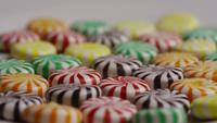 Rotating shot of a colorful mix of various hard candies - CANDY MIXED 028