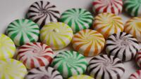 Rotating shot of a colorful mix of various hard candies - CANDY MIXED 018