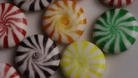 Rotating shot of a colorful mix of various hard candies - CANDY MIXED 006