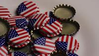 Rotating shot of bottle caps with the American flag printed on them - BOTTLE CAPS 032