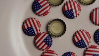 Rotating shot of bottle caps with the American flag printed on them - BOTTLE CAPS 002