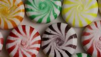 Rotating shot of a colorful mix of various hard candies - CANDY MIXED 010