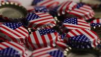 Rotating shot of bottle caps with the American flag printed on them - BOTTLE CAPS 042