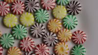 Rotating shot of a colorful mix of various hard candies - CANDY MIXED 002