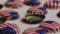 Rotating shot of bottle caps with the American flag printed on them - BOTTLE CAPS 018