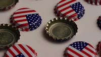 Rotating shot of bottle caps with the American flag printed on them - BOTTLE CAPS 011