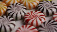 Rotating shot of a colorful mix of various hard candies - CANDY MIXED 022