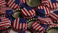 Rotating shot of bottle caps with the American flag printed on them - BOTTLE CAPS 033